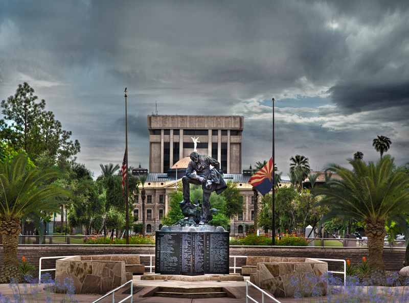 Fallen Officers memorial with clouds in the background.